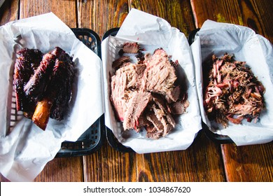 ribs, brisket, and pulled pork