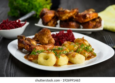 Ribs in honey and Silesian dumplings served with beetroot and sauce