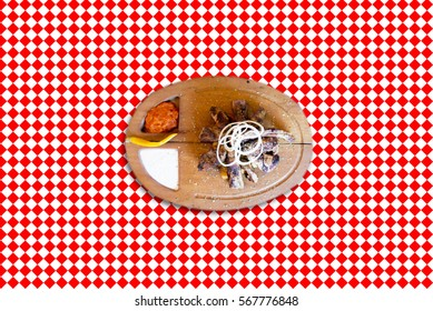Ribs on a red and white oilcloth
