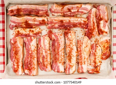 Ribs on the tray prepared for the oven