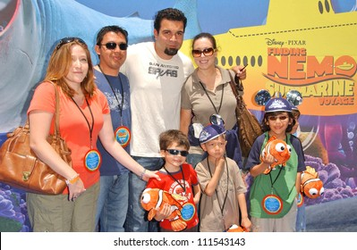 "Ricardo Chavira with son Tomas and friends at the Opening of Disneyland's ""Finding Nemo Submarine Voyage"". Disneyland, Anaheim, CA. 06-10-07"