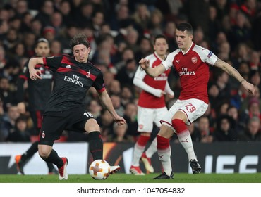 Riccardo Montolivo of AC Milan and Granit Xhaka of Arsenal during the Europa League match between Arsenal and AC Milan at The Emirates Stadium on March 15, 2018 in London, United Kingdom.