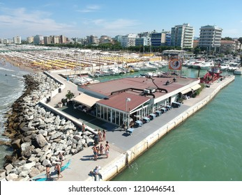 Riccione, Emilia Romagna / Italy - 06/15/2018 : Aerial view of the port of Riccione and the coastline seen from the canal port