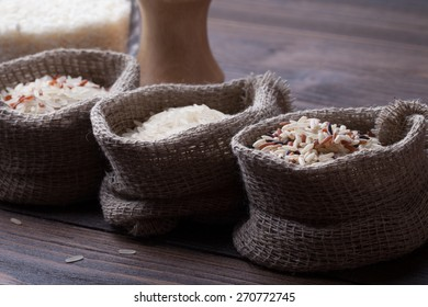 rice in bags on a brown wooden table