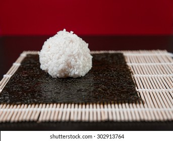 rice ball for sushi on the mat.