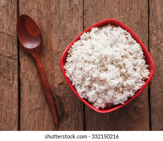 Rice berry, Brown rice in a bowl on brown wooden background, Rice berry in brown bowl and wooden spoon, Rice bowl or rice berries