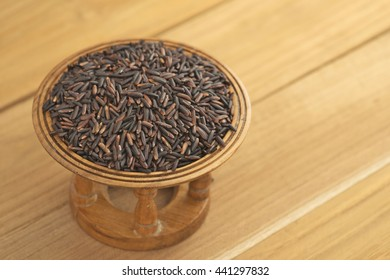 Rice berry, a kind of newly crossbred Jasmine rice, on wooden tray. The rice is well known for it rich of nutritious