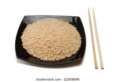 Rice in a black plate and chopsticks; isolated on white