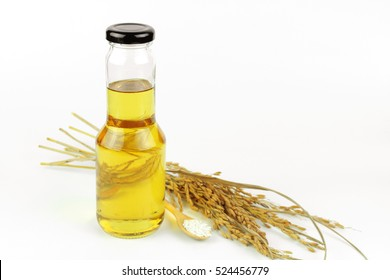 Rice bran oil in bottle glass and rice