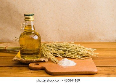 rice bran oil extracted from rice, healthy for cooking. It contained in a glass-bottle
