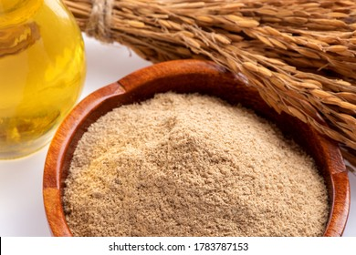 Rice bran ,rice seeds and oil in the bottle on a white background.