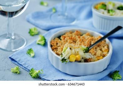 Rice broccoli corn casserole on a light background. toning. selective focus