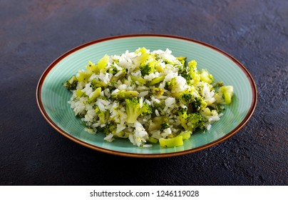 Rice, broccoli and pepper dish on plate