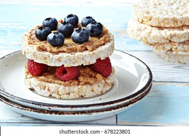 Rice cake with peanut butter and berries