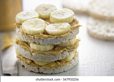 Rice cake sandwich with peanut butter and banana slices