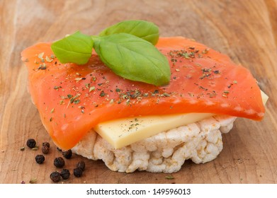 Rice cakes with cheese, smoked salmon and basil.