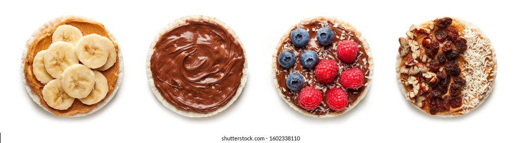 Rice cakes with chocolate, berries, banana and nuts top view isolated on white background