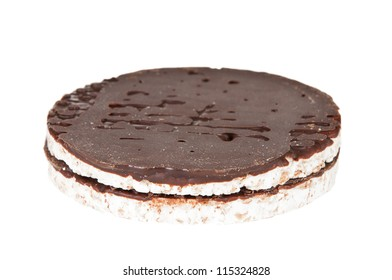 Rice cakes with chocolate over a white background