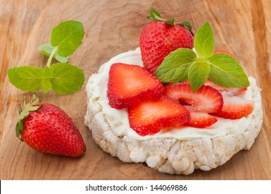 Rice cakes with cream cheese strawberries and basil.