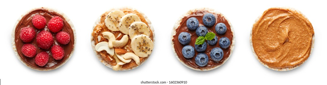 Rice cakes with nuts, banana, peanut butter, berries top view isolated on white background