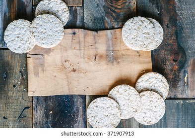 Rice cakes on old wooden background with space for text