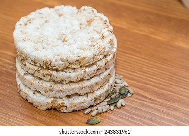 Rice cakes and seeds isolated on wooden background