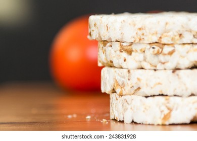 Rice cakes and seeds isolated with tomatoe in background