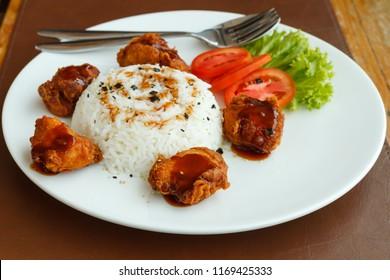 Rice chicken karaage decorate on white plate