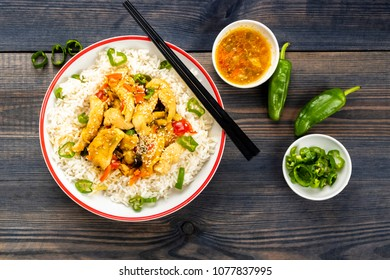 rice with chicken and vegetables sprinkled with sesame seeds