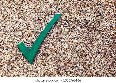 Rice: choosing a healthy diet - correct choice for wholemeal rice - food concept with design / text space.