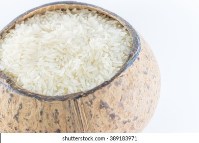 Rice in a coconut shell on a white background.
