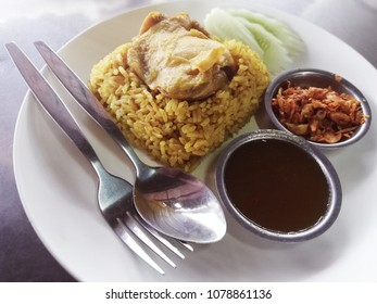 rice cooked with chicken in curry