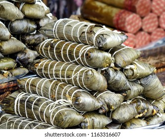 Rice is cooked wrapped in palm leaves, a native Taiwan specialty