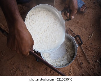 Rice cooking on old charcoal stove
