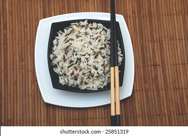 rice in cup and chinese sticks