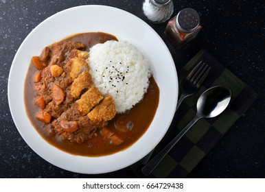 Rice with deep fried pork and curry in Japanese style or katsu kare in white  plate ready to eat.