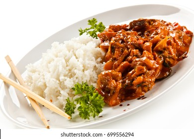 Rice dish with sauce on white background