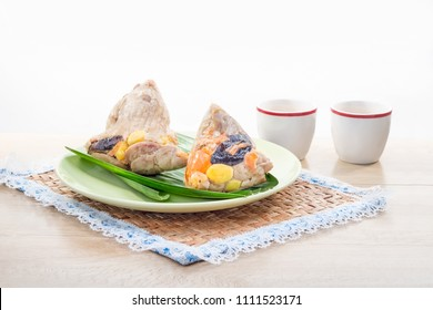 Rice dumplings or zongzi is a traditional Chinese food, made of glutinous rice stuffed with different fillings and wrapped in bamboo or reed leaves. They are cooked by steaming or boiling.