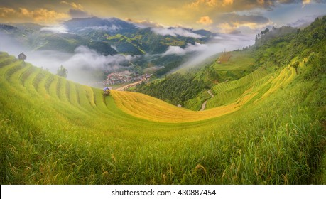 Rice fields in terraced on high mountain over the city and fog