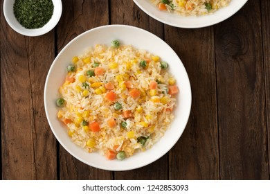 rice fire with vegetable on white plate