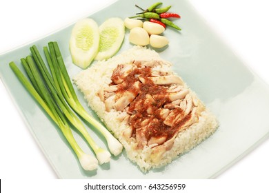 rice with fired chicken on plate with vegetable.