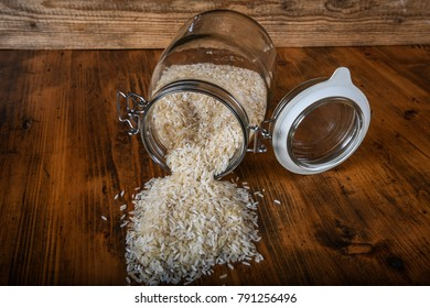 Rice in a glass jar on wooden table
