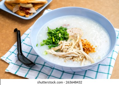 rice gruel in bowl on tablecloth in morning