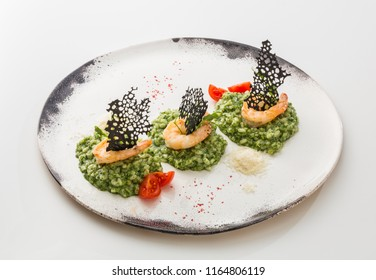 Rice with herbs and shrimps isolated on white background.