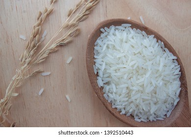 Rice is the main food of Thailand. Placed on wooden table background.
