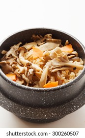 rice, meat and vegetable dish served in a small pot