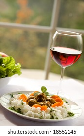 Rice and meatballs, red wine - delicious dinner