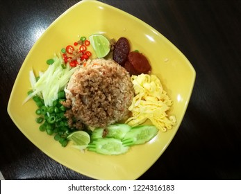 """Rice Mixed with Shrimp paste that Thai food call """"kao kook ka pi"""" Serve the rice with string bean, sliced red chilli papper, mango, eggs, red onions, lemon, pork, cucumber, dried shrimp"""