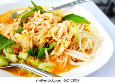 Rice noodles in fish curry sauce with vegetables menu