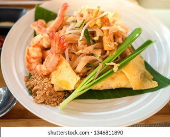 Rice noodles (Pad Thai) with shrimps and vegetables close-up on the table., traditional Thai dish with stir fried rice noodles.